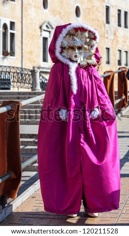 VENICE,ITALY-FEB. 26: Unidentified person wearing specific pink costume and mask on February 26, 2011 in Venice, Italy. In 2011 the Carnival was held between 11- 21 February.