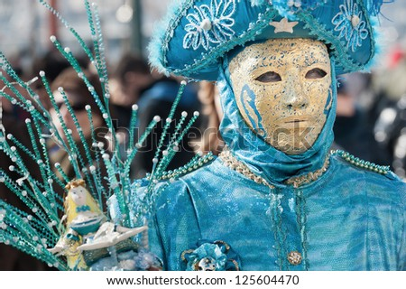 VENICE,ITALY-FEB.17: Unrecognizable person wearing carnival costume and posing along Saint Mark waterfront on February 17, 2012 in Venice, Italy. In 2012 the Carnival was held between 11-21 February.
