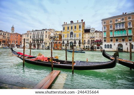 VENICE, ITALY - FEBRUARY 15 : A view of an empty gondola parked in a Campo Erberia square on grand canal on February 15th, 2014 in Venice, Italy.
