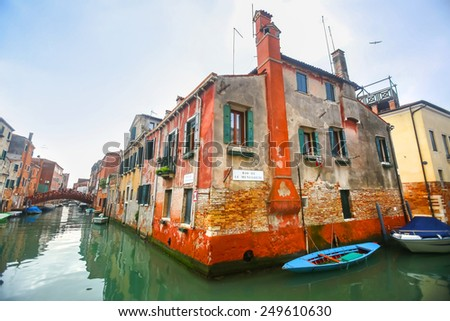 VENICE, ITALY - FEBRUARY 15 : A view of empty boats parked next to buildings in a water canal on February 15th, 2014 in Venice, Italy.