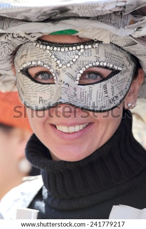 VENICE, ITALY - February 23: An unidentified young woman wears a mask made with newspaper sheets during the traditional festival of Carnival on February 23, 2014 in Venice, Italy