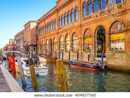Venice, Italy - 11 February 2016: Buildings and Stores by the Canal on Murano Island in Venice, Italy. - stock photo