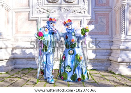 VENICE, ITALY, FEBRUARY 23, 2014: Carnival of Venice, beautiful masks at St. Mark's Square