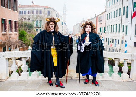VENICE, ITALY - FEBRUARY 9, 2016: Carnival of Venice. People showing beautiful, colorful and funny masks in Piazza San Marco for the famous event.