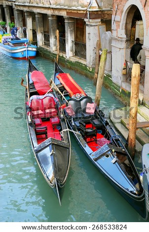 VENICE, ITALY-FEBRUARY 10, 2007: : city life and typical gondola in Cannaregio area.  Venice is a great tourists attraction with more than 27 million tourists every year - stock photo