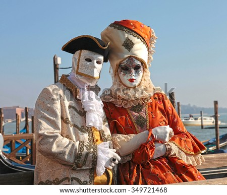 VENICE, ITALY - FEBRUARY 8, 2015: Costumed people in Venetian mask on the Piazza San Marco during Venice Carnival in Venice, Italy. Selective focus - stock photo