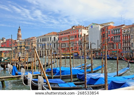 VENICE, ITALY-FEBRUARY 14, 2007: gondoliers, gondolas and buildings on the grand canal. Venice is a great tourists attraction with more than 27 million tourists every year.  - stock photo