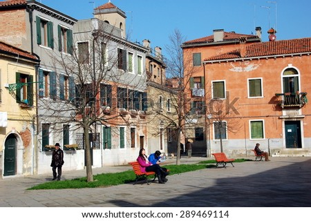 VENICE, ITALY - FEBRUARY 21: One of the squares in Venice with people relaxing at the sun. - Feb 21, 2014. Italy, Venice. - stock photo