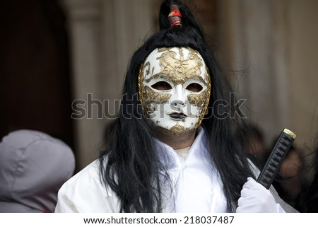 Venice, Italy - February 11, 2012: People posing wearing a typical Carnival mask in St. Mark's Square