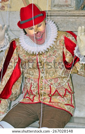 VENICE, ITALY - FEBRUARY 12: Pinocchio costume at the 2015 Venice Carnival:  February  12, 2015 in Venice, Italy - stock photo