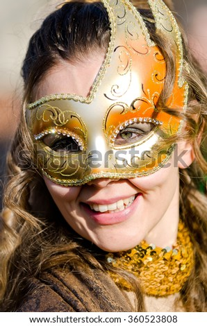 Venice, Italy - February 26th, 2011: portrait of beautiful smiling girl with traditional clothing Venetians During the Carnival in Piazza San Marco