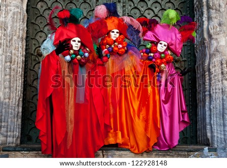 VENICE, ITALY - FEBRUARY 14: Three venetian masks posing  in front of  Basilica Saint Mark, Carnival of Venice on February 14, 2010. The carnival was held in 2010 from February 6 to February 16, 2010