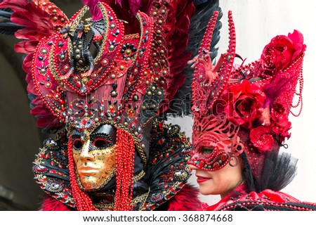 VENICE, ITALY - FEBRUARY 15, 2015: Two models disguised with similar carnival costumes at the Carnival of Venice in Italy. - stock photo