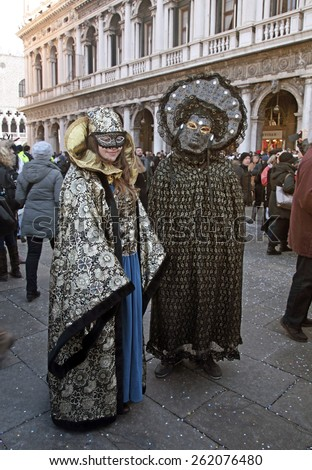 VENICE, ITALY - FEBRUARY 8, 2015: Two unidentified masked persons in costume on San Marco Square during the Carnival in Venice, Italy. - stock photo