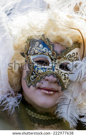 VENICE, ITALY - FEBRUARY 9, 2013: Unidentified person with Venetian carnival mask in Venice, Italy. At 2013 it is held from January 26th to February 12th.