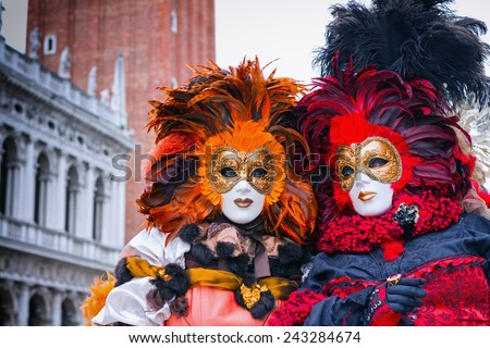 VENICE, ITALY - FEBRUARY 27, 2014: Unidentified person with Venetian Carnival mask in Venice, Italy on February 2014. In 2014 was the Venetian Carnival held between 15 February and 4 march  - stock photo