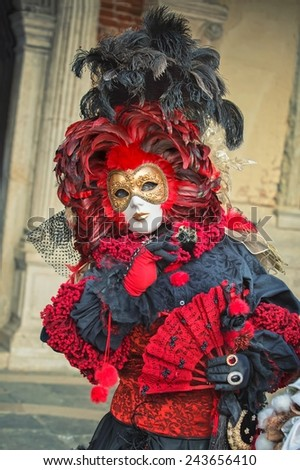 VENICE, ITALY - FEBRUARY 27, 2014: Unidentified person with Venetian Carnival mask in Venice, Italy on February 2014.  For only editorial - stock photo