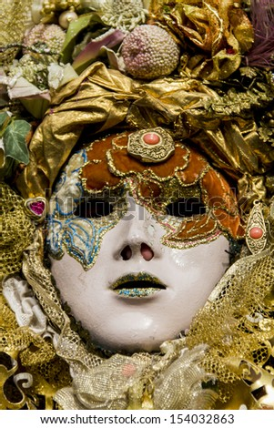 VENICE, ITALY - FEBRUARY 10: Unidentified person with Venetian carnival mask in Venice, Italy at February 10, 2013. At 2013 it is held from January 26th to February 12th.