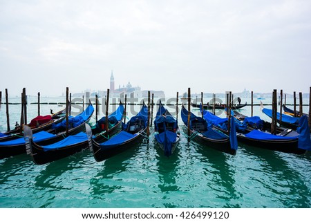 VENICE, ITALY, FEBRUARY 9, 2016: View of Canal Grande in Venice with a gondolier taking tourist with his gondola