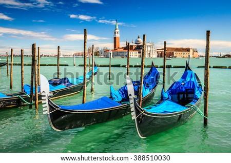 Venice Italy. Gondolas moored by San Marco Square with San Giorgio di Maggiore church in the background - Venezia, Europe. - stock photo