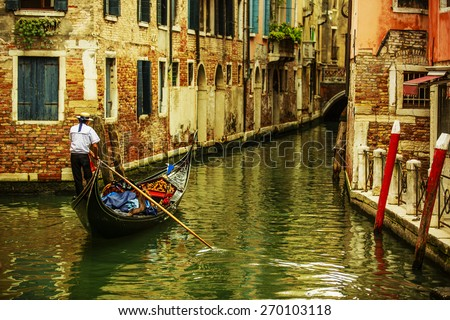 Venice, Italy - Gondolier and historic tenements (filtered) - stock photo