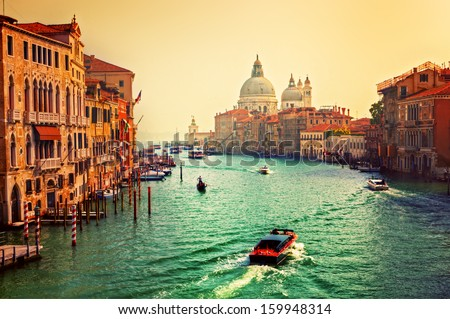 Venice, Italy. Grand Canal and Basilica Santa Maria della Salute at sunset. View from Ponte dell Accademia - stock photo
