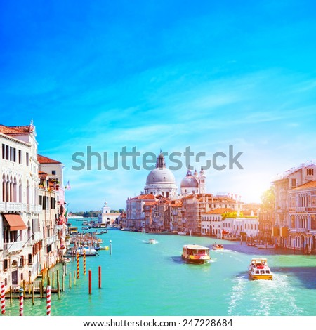 Venice, Italy. Grand Canal and the Salute at sunny day. Tourist boats View from Ponte dell Accademia - stock photo