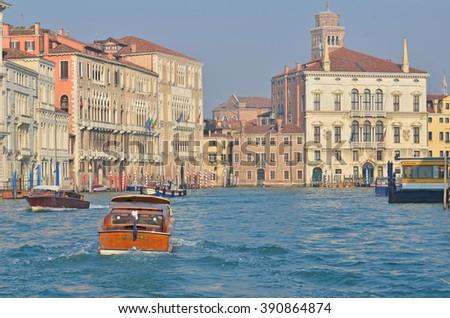 VENICE, ITALY - JANUARY 27: Boats travel up and down the Grand Canal in Venice: January 27, 2016 in Venice, Italy - stock photo