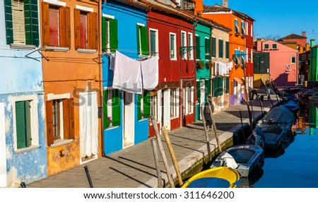 VENICE, ITALY. January 11, 2006. Colourful buildings on the island of Murano - stock photo