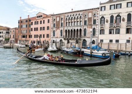 Venice, Italy - July 27, 2016: Gondola with tourists on Canal Grande (grand channel)