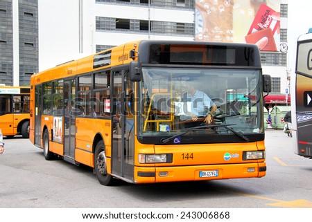 VENICE, ITALY - JULY 30, 2014: Orange city bus Iveco CityClass at the city street. - stock photo