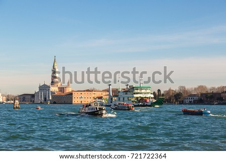 VENICE, Italy, JULY 12, 2016: San Giorgio island and boats in a summer day in Venice, Italy