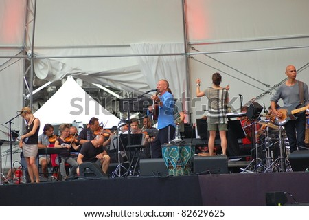 VENICE, ITALY – JULY 29: Singer Sting on stage at St. Mark's Square during rehearsal before evening concert performing his biggest hits with symphonic arrangements on July 29, 2011 in Venice, Italy