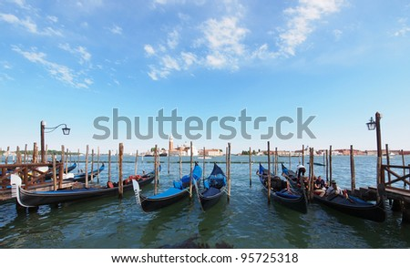 VENICE, ITALY - JULY,02: Tourists enjoy at the Gondolas on San Marco Canal in Venice, Italy on July 02, 2011. Today there are only 500 gondolas and about 400 licensed gondoliers in Venice.