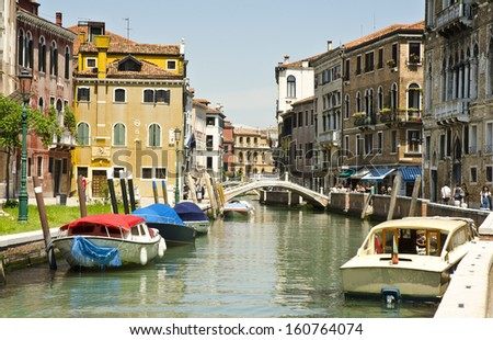 VENICE, ITALY - JUNE 6: a canal on June 6, 2013 in Venice, Italy. Venice is one of the world's most popular tourist destinations with 21 million visitors per annum.