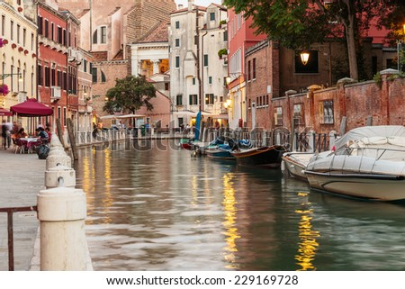 VENICE, ITALY - 26 JUNE, 2014: Canal in Venice at night. - stock photo