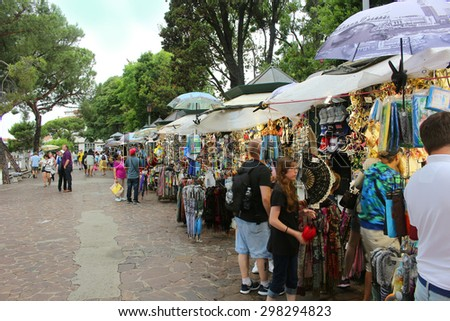 VENICE,ITALY ,JUNE 25, 2015: Outside vendors selling goods to tourists in Venice Italy on June 25, 2015