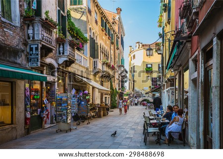 VENICE, ITALY - JUNE 26, 2014: People on the street in Venice, Italy - stock photo