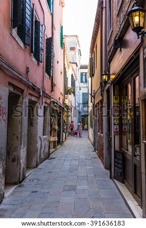 VENICE, ITALY - JUNE 26, 2014: People on the street in Venice, Italy