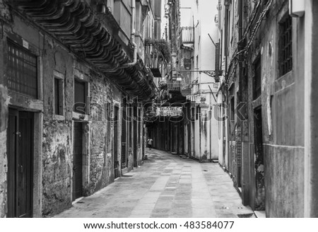 VENICE, ITALY - JUNE 26, 2014: People on the street in Venice, Italy  . Black and white photography.