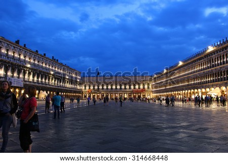 VENICE, ITALY - JUNE 22, 2015: Piazza San Marco in late evening lit up after a rainfall