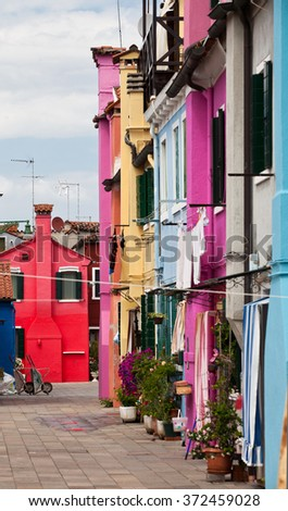 VENICE, ITALY - JUNE 28, 2013: The chimneys in the back yard. Burano island