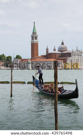 VENICE, ITALY - 26 JUNE, 2014: Tourists ride on a gondola