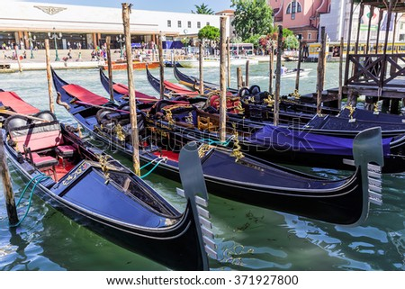 VENICE, ITALY - June 26, 2014: Tourists travel on gondolas in Venice, Italy. Gondola ride is the most popular tourist activities in Venice.