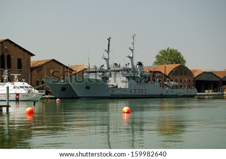 VENICE, ITALY - JUNE 8: Transport ship Procida with another Italian Navy ship docked in the Arsenale in Venice on June 8 2013.  The dockyard has been used by the country's naval forces for centuries.