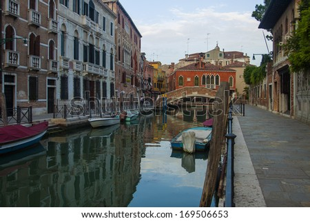 Venice, Italy, June 20, 2012. Typical city street view and channel in early summer evening