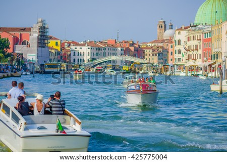 VENICE, ITALY - JUNE 18, 2015: Unidentified tourists visitting Venice on boat taxi, water transportation.