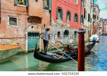VENICE, ITALY - JUNE 04, 2016 -  Venice view of the lagoon city with its canals and bridges with the famous St. Mark's Square and the basilica with a bell tower  Carnaval de Venise et Masques