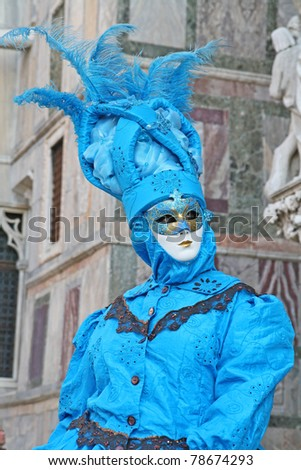 VENICE, ITALY - MARCH 3: An unidentified masked person stands in front of the Palazzo Ducale during the Venice Carnival on March 3, 2011 in Venice, Italy. The carnival is from February 26 - March 8, 2011.