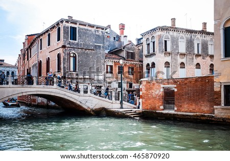 VENICE, ITALY - March 26, 2016. Beautiful view of water street and old buildings in Venice on May 26, 2015. its entirety is listed as a World Heritage Site, along with its lagoon.May 26 VENICE, ITALY